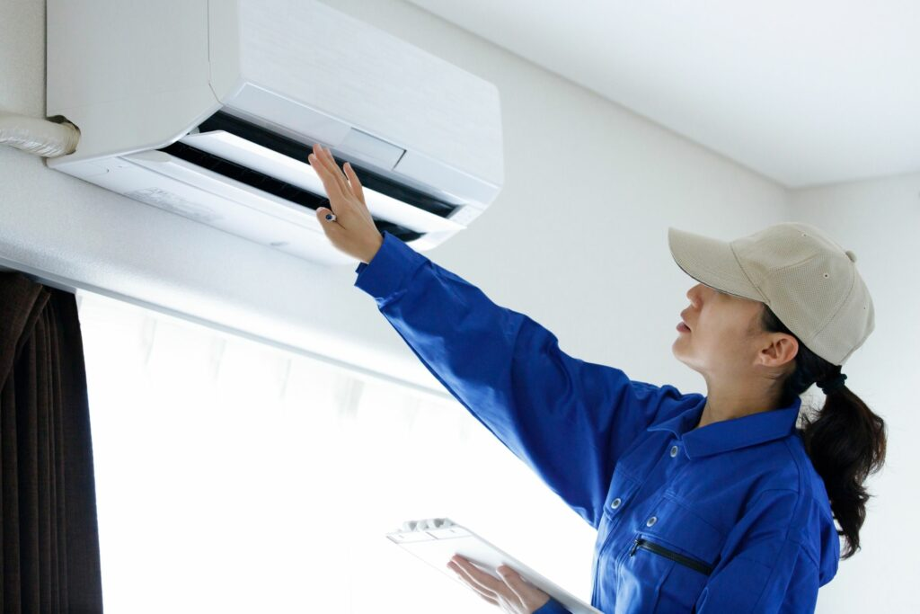 Tech checking why AC is not working properly