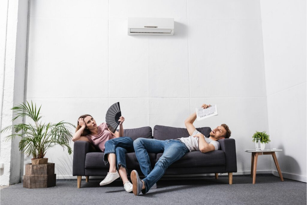 woman and man are hot because their AC unit is broken and they need a new AC
